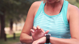 Fit woman setting heart rate watch Footage
