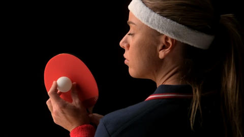 Female ping pong player holding ball and racket Footage