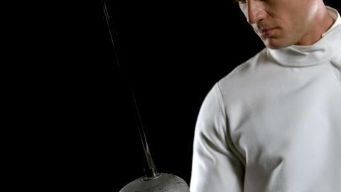 Fencing player looking at his sward Footage