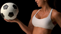 Female athlete holding football Footage