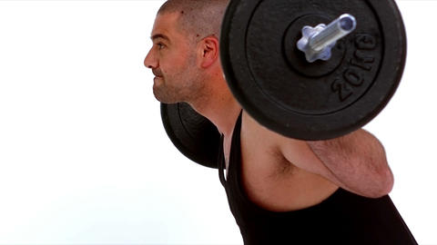 Determined man lifting heavy barbell Live Action