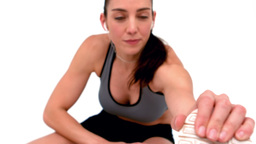 Smiling female athlete stretching her leg Footage