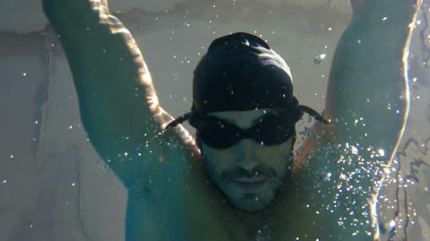 Underwater view of man swimming and diving Footage