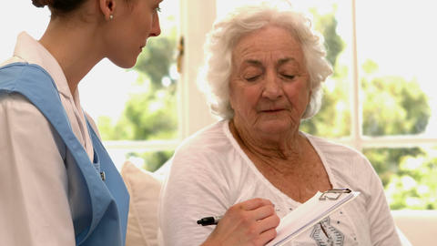 Senior woman talking to nurse Footage