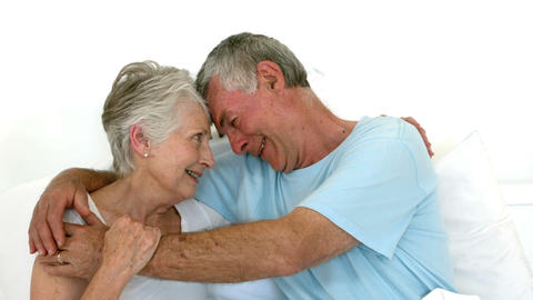 Senior couple embracing on bed Footage