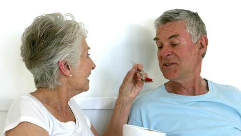 Senior woman feeding her husband Footage