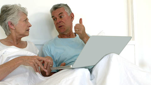 Senior couple using laptop together Footage