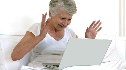 Senior woman doing a video chat Footage