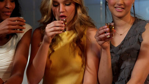 Cute friends having shots at a party Footage