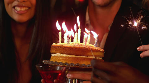 Happy friends celebrating birthday with cake Stock Video Footage