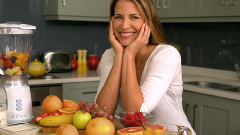 Pretty woman preparing a smoothie Footage
