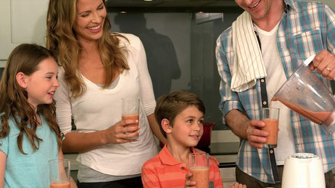 Cute family preparing a smoothie Footage