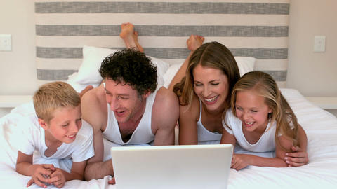 Cute family using laptop Footage