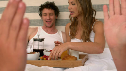 Cute family having breakfast in bed Footage