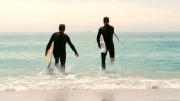Men with surfboards running Footage