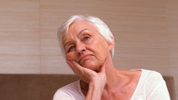 Thoughtful Old Woman In Her Room stock footage