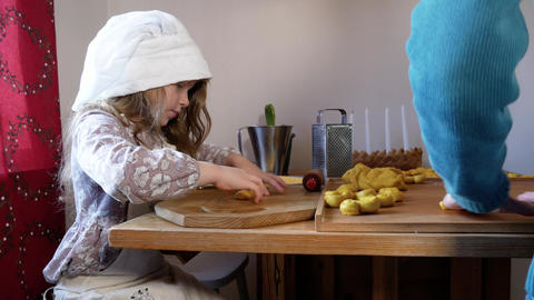 A young girl bakes saffron buns with her grandmother Footage