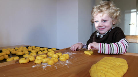 A little boy and his grandmother are baking in the kitchen Live Action