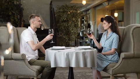 Happy Woman and Man Taste Old Red Wine in Restaurant Footage