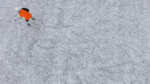aerial view of men playing hockey on a frozen lake in a city park. Ice hockey ビデオ