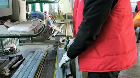 plastic windows. Worker Cutting PVC Profile with Circular Saw.PVC windows and 画像