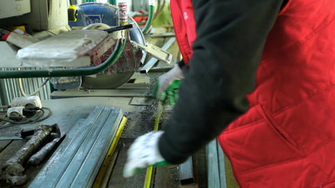 plastic windows. Worker Cutting PVC Profile with Circular Saw.PVC windows and Footage