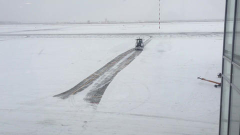 clearing from snow by an aerodrome tractor Footage