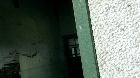 Camera move into window abandoned building Footage