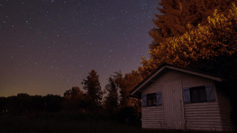 Time lapse starry sky and wooden cabin in Ardennes forest Footage