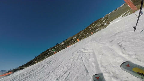POV of skier braking and passing turnstiles Footage