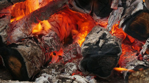 Firewood and hot coal in a grill, fire burning for the meat cooked Footage