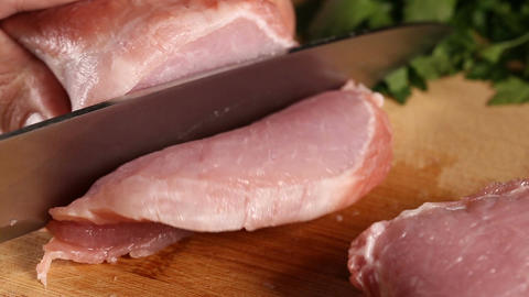 Slicing raw pork meat Footage