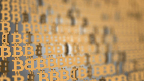 wall of golden bitcoins. business background. seamless loop Filmmaterial
