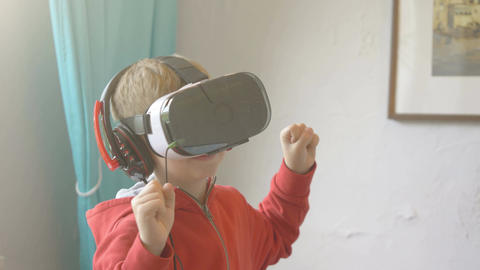 Video of boy exploring virtual reality and playing games in 4k Footage