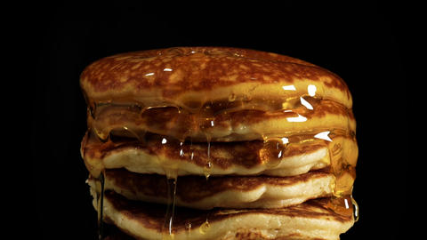 Close up Syrup flows down on a pile of pancakes Footage