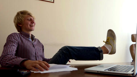 Man Puts His Feet on a Table, Crumbles His Doc, Throws it Away in an Office Live-Action
