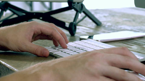 A Caucasian Male Typing on a Wireless Keyboard Live Action