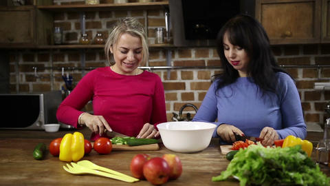 Cheerful women preparing healthy salad in kitchen Live Action