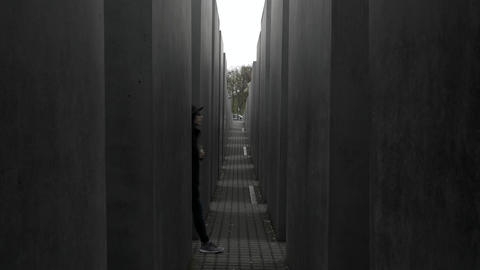 Girl/Woman walking in the Memorial to the Murdered Jews of Europe in Berlin Live Action