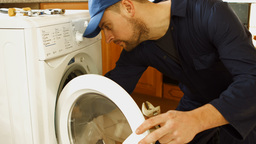 Man fixing the washing machine Footage