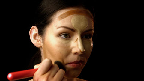 Beautiful woman applying make up Footage