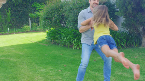 Father and daughter having fun in the garden Footage