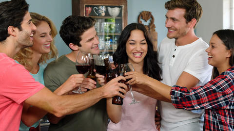 Happy friends cheering with wine glasses Footage