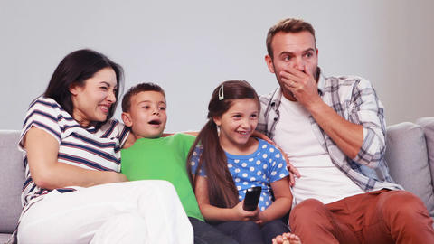 Laughing then afraid family watching tv Live Action