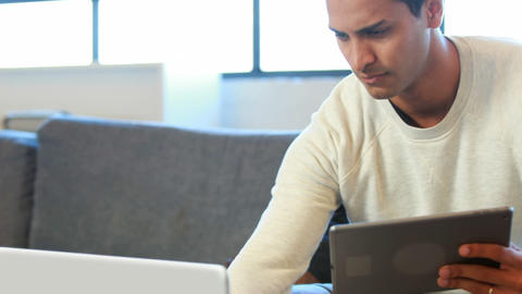 Man using tablet and laptop Footage