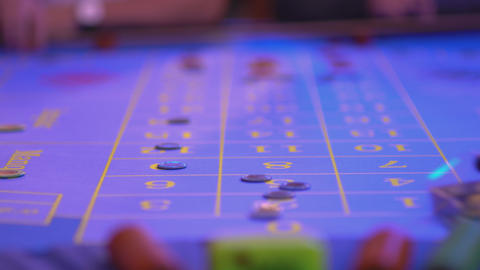 Roulette table in a casino - groupier removes lost tokens... Stock Video Footage