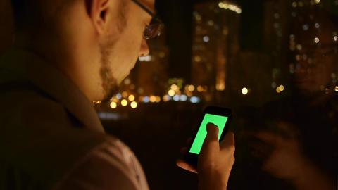 men scrolls browser on phone Live Action