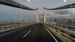 Sunset drive over the Rainbow Bridge lighting up Footage