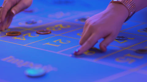 Roulette table in a casino - setting bets on roulette table - close up shot Footage