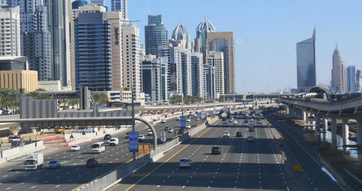 Rapid commuters in sunshine in Jumeirah district on the Sheik Zayed Highway Footage